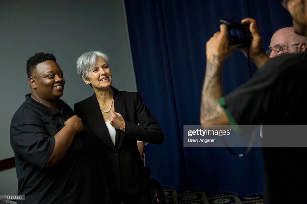 Jill Stein poses for a photo with a supporter after she announced that she will seek the Green Party's presidential nomination, at the National Press Club, June 23, 2015 in Washington, DC. Stein also ran for president in 2012 on the Green Party ticket.