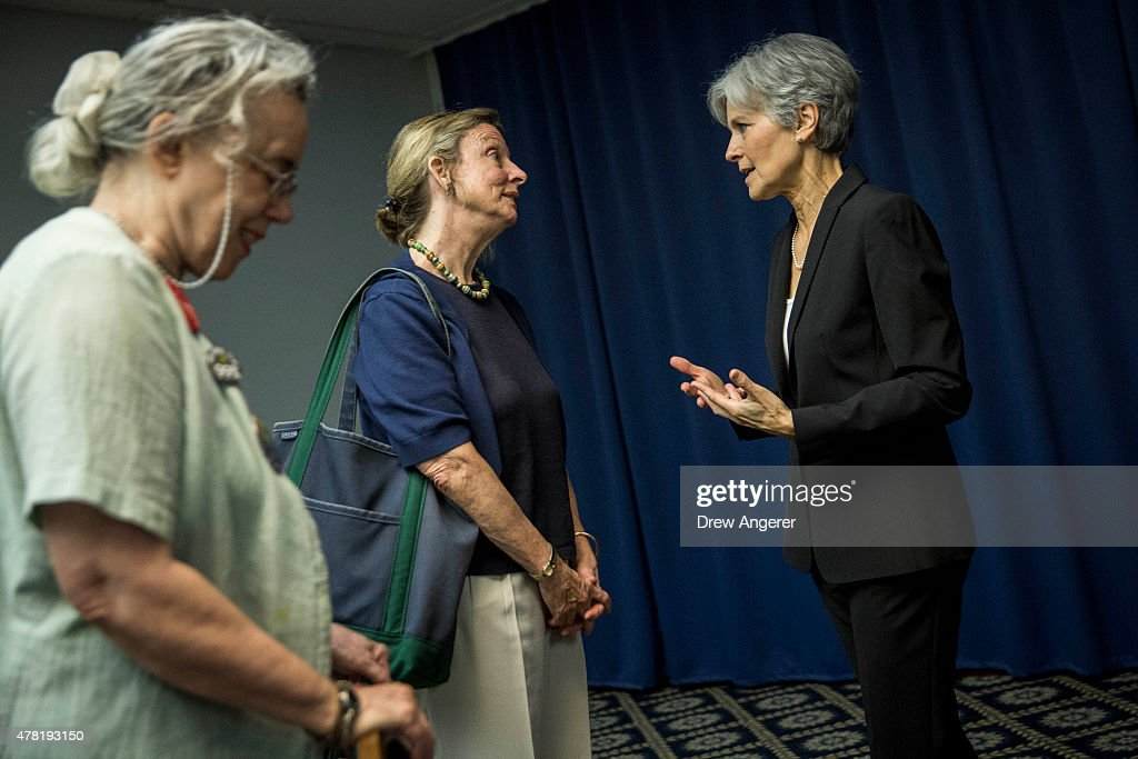 Jill Stein (R) talks with supporters after she announced that she will seek the Green Party's presidential nomination, at the National Press Club, June 23, 2015 in Washington, DC. Stein also ran for president in 2012 on the Green Party ticket.