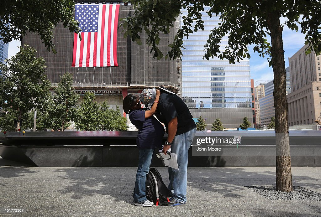 Jillian and Eloy Suarez embrace following ceremonies for the eleventh anniversary of the terrorist attacks on lower Manhattan at the World Trade Center on September 11, 2012 in New York City. New York City and the nation are commemorating the eleventh anniversary of the September 11, 2001 attacks which resulted in the deaths of nearly 3,000 people after two hijacked planes crashed into the World Trade Center, one into the Pentagon in Arlington, Virginia and one crash landed in Shanksville, Pennsylvania.