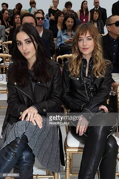 Jillian Banks and Dakota Johnson attend the Chanel show as part of Paris Fashion Week Haute Couture Fall/Winter 20142015 at Grand Palais on July 8...