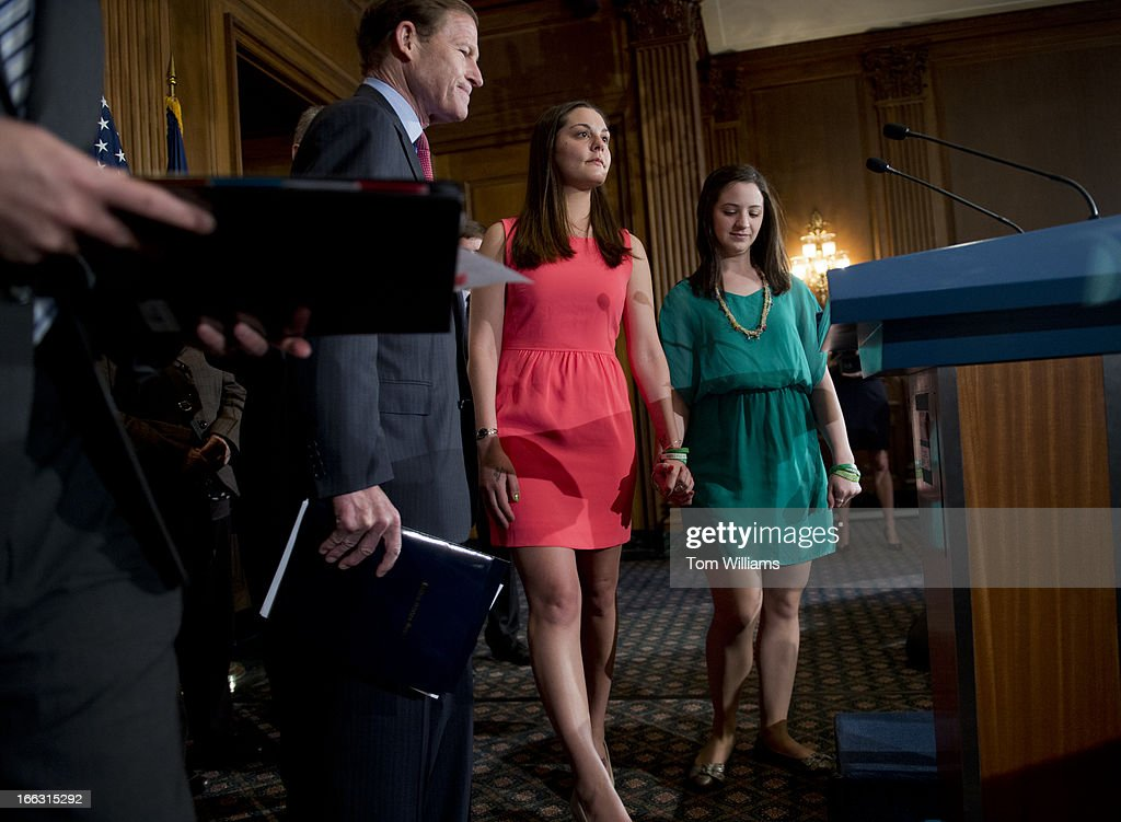 Jillian Soto, right, and Erica Lafferty, prepare to speak at a news conference in the Capitol to support legislation that will improve background checks for gun buyers in order to make schools safer and stop illegal gun trafficking. In the Sandy Hook Elementary School shootings, Soto lost her sister Vicki Soto, who was a teacher, and Lafferty lost her mother Dawn Hochsprung, who was the principal. Richard Blumenthal, D-Conn., appears at left.