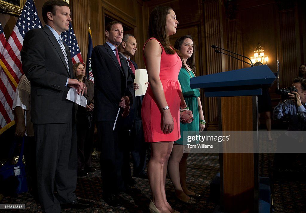 Jillian Soto, right, and Erica Lafferty, speak at a news conference in the Capitol to support legislation that will improve background checks for gun buyers in order to make schools safer and stop illegal gun trafficking. In the Sandy Hook Elementary School shootings, Soto lost her sister Vicki Soto, who was a teacher, and Lafferty lost her mother Dawn Hochsprung, who was the principal. Behind them from left are, Sen. Chris Murphy, D-Conn., Richard Blumenthal, D-Conn., and Chuck Schumer, D