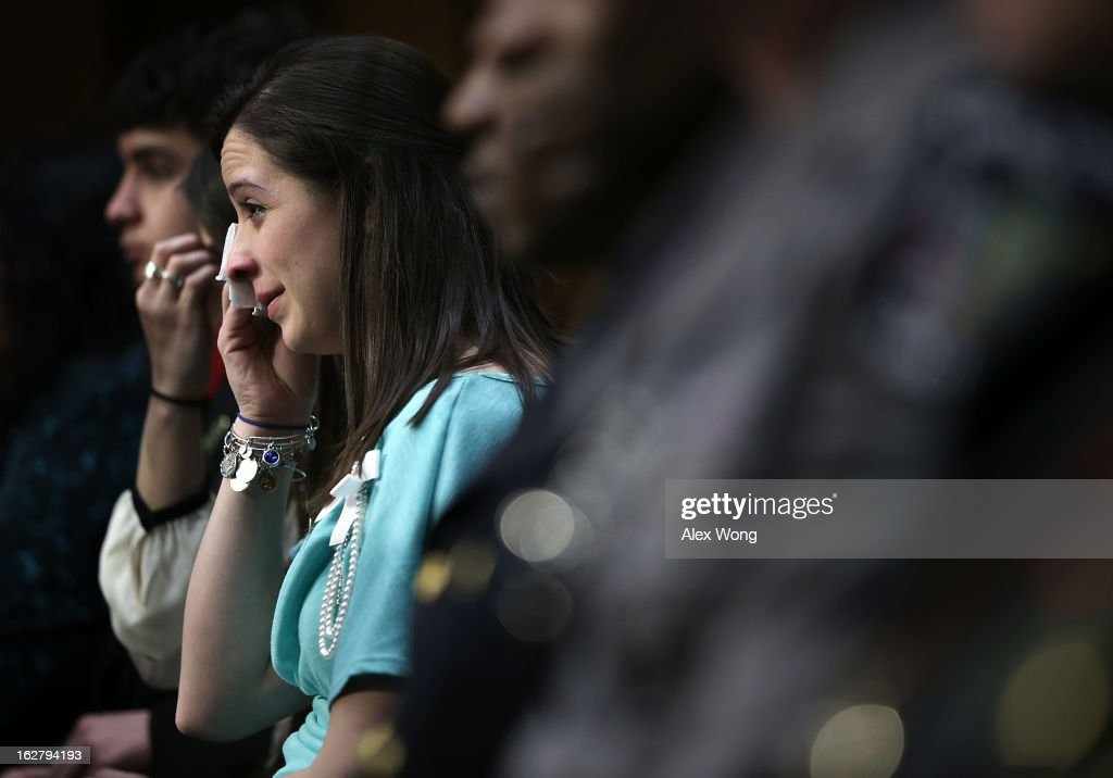 Jillian Soto, sister of Sandy Hook Elementary shooting victim first-grade teacher Victoria Soto, wipes tears during a hearing before the Senate Judiciary Committee February 27, 2013 on Capitol Hill in Washington, DC. The committee held a hearing on 'The Assault Weapons Ban of 2013.'