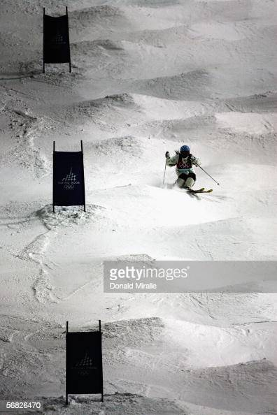 Jillian Vogtli of the United States in happy mood after completing the first run in the Womens Freestyle Skiing Moguls Final on Day 1 of the 2006...
