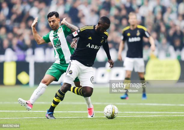 Jiloan Hamad of Hammarby IF and Henok Goitom of AIK competes for the ballduring the Allsvenskan match between Hammarby IF and AIK at Tele2 Arena on...