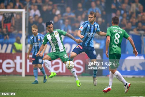 Jiloan Hamad of Hammarby IF and Jesper Karlstrom of Djurgardens IF competes for the ball during the Allsvenskan match between Djurgardens IF and...