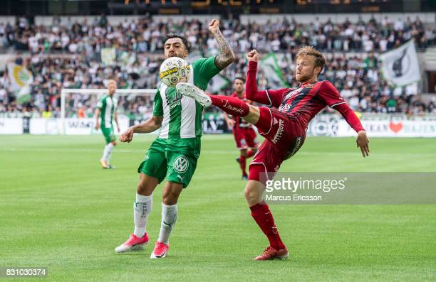 Jiloan Hamad of Hammarby IF and Johan Bertilsson of Ostersunds FK during the Allsvenskan match between Hammarby IF and Ostersunds FK at Tele2 Arena...
