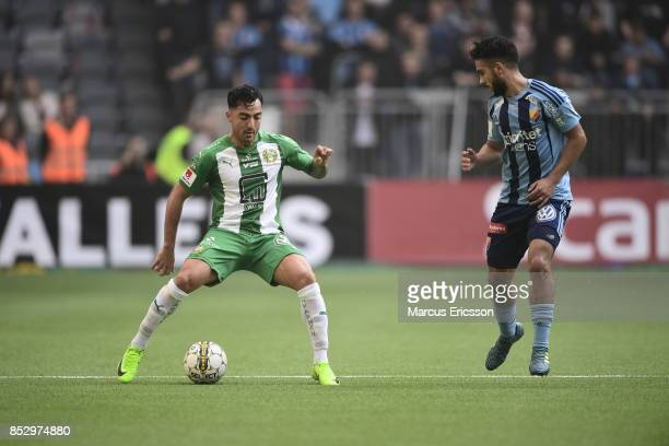 Jiloan Hamad of Hammarby IF and Othman El Kabir of Djurgardens IF competes for the ball during the Allsvenskan match between Djurgardens IF and...