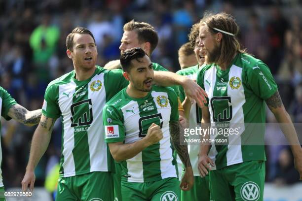 Jiloan Hamad of Hammarby IF celebrates with team mates after scoring 02 during the Allsvenskan match between Halmstad BK and Hammarby IF at Orjans...