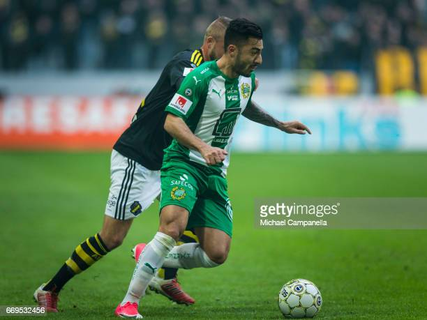 Jiloan Hamad of Hammarby IF in a duel with Daniel Sundgren of AIK during an Allsvenskan match between AIK and Hammarby IF at Friends arena on April...