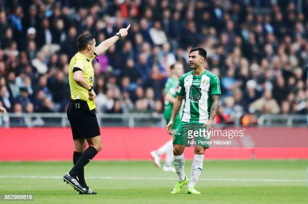 Jiloan Hamad of Hammarby IF receives yellow card from Bojan Pandzic referee during the Allsvenskan match between Djurgardens IF and Hammarby IF at...