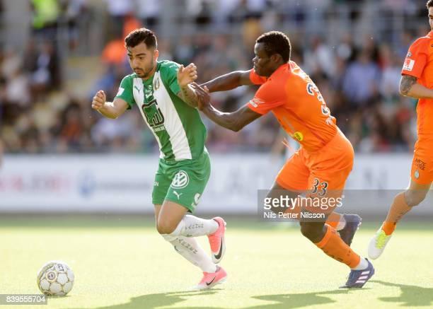 Jiloan Hamad of Hammarby IF Taye Taiwo of Athletic FC Eskilstuna competes for the ball during the Allsvenskan match between Athletic FC Eskilstuna...