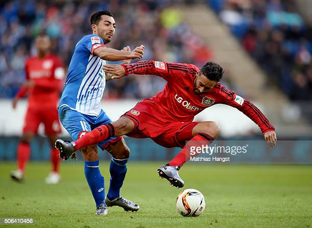 Jiloan Hamad of Hoffenheim tackles Karim Bellarabi of Leverkusen during the Bundesliga match between 1899 Hoffenheim and Bayer Leverkusen at Wirsol...