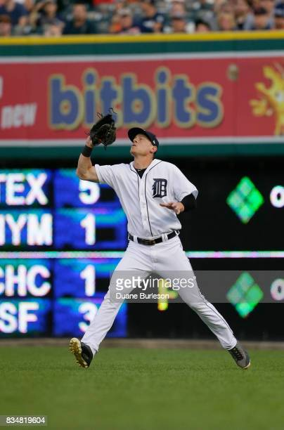 Jim Adduci of the Detroit Tigers catches a fly ball against the Pittsburgh Pirates during an interleague game at Comerica Park on August 9 2017 in...