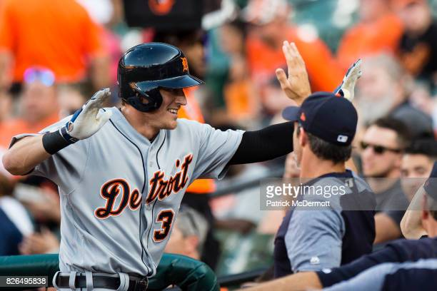 Jim Adduci of the Detroit Tigers celebrates with his teammates after hitting a solo home run in the first inning during a game against the Baltimore...