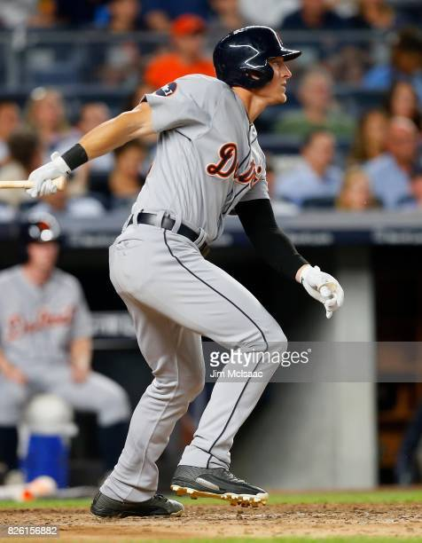 Jim Adduci of the Detroit Tigers follows through on a sixth inning RBI base hit against the New York Yankees at Yankee Stadium on July 31 2017 in the...