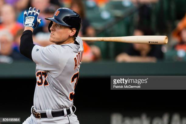 Jim Adduci of the Detroit Tigers hits a solo home run in the first inning during a game against the Baltimore Orioles at Oriole Park at Camden Yards...