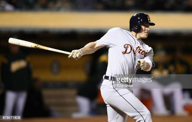 Jim Adduci of the Detroit Tigers hits a threerun triple in the sixth inning against the Oakland Athletics at Oakland Alameda Coliseum on May 5 2017...