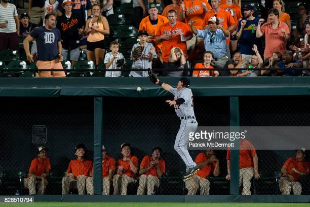 Jim Adduci of the Detroit Tigers is unable to catch a double hit by Seth Smith of the Baltimore Orioles in the seventh inning during a game at Oriole...