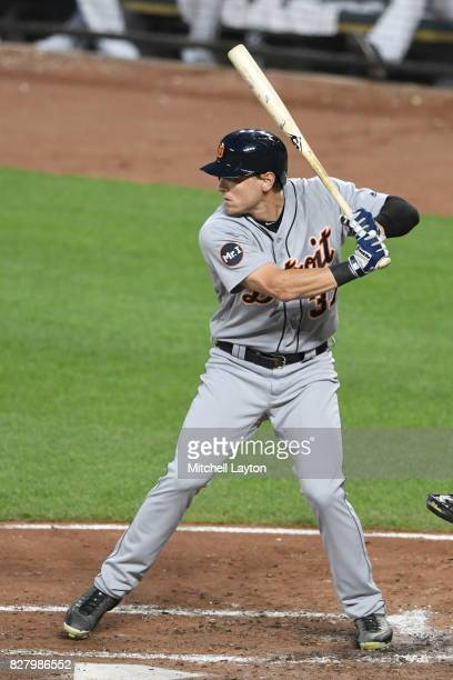 Jim Adduci of the Detroit Tigers prepares for a pitch during a baseball game against the Baltimore Orioles at Oriole Park at Camden Yards on August 5...