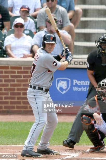 Jim Adduci of the Detroit Tigers prepares for a pitch during a baseball game against the Baltimore Orioles at Oriole Park at Camden Yards on August 6...