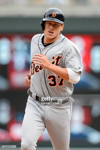 Jim Adduci of the Detroit Tigers runs the bases against the Minnesota Twins during the game on April 23 2017 at Target Field in Minneapolis Minnesota...