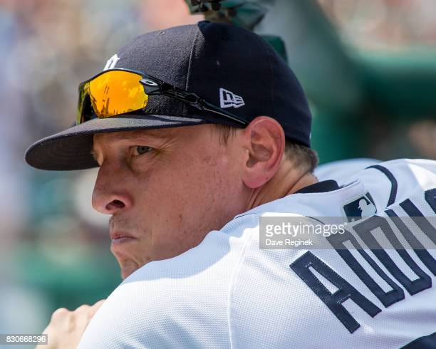 Jim Adduci of the Detroit Tigers watches the action from the dugout against the Pittsburgh Pirates during a MLB game at Comerica Park on August 10...