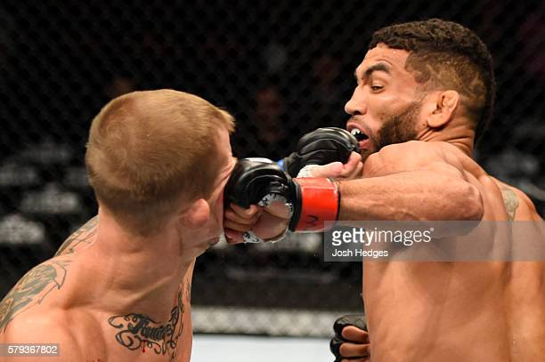 Jim Alers punches Jason Knight in their featherweight bout during the UFC Fight Night event at the United Center on July 23 2016 in Chicago Illinois
