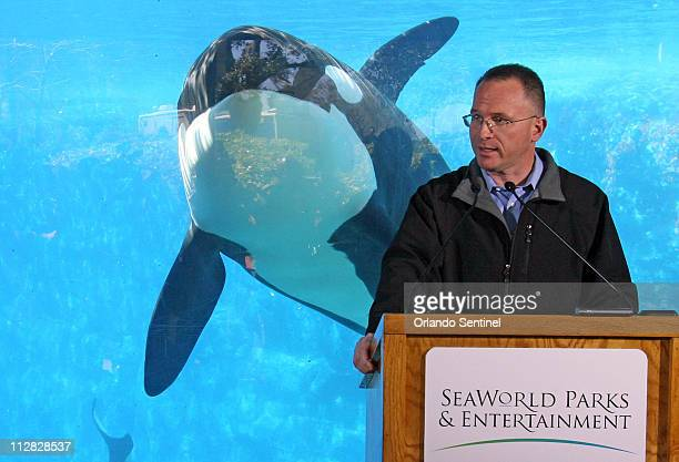 Jim Atchison president and CEO SeaWorld Parks Entertainment speaks during a news conference Friday February 26 with a killer whale behind observation...