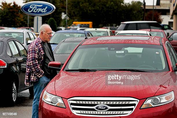 Jim Baillie looks at the sticker price on a 2010 Ford Taurus at Capital Ford dealership in Raleigh North Carolina US on Sunday Nov 1 2009 Ford Motor...