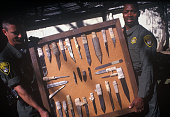 Jim Bales left and Ray Harrington prison guards at Old Folsom State Prison hold up a display of illegal weapons or 'shanks' confiscated from...