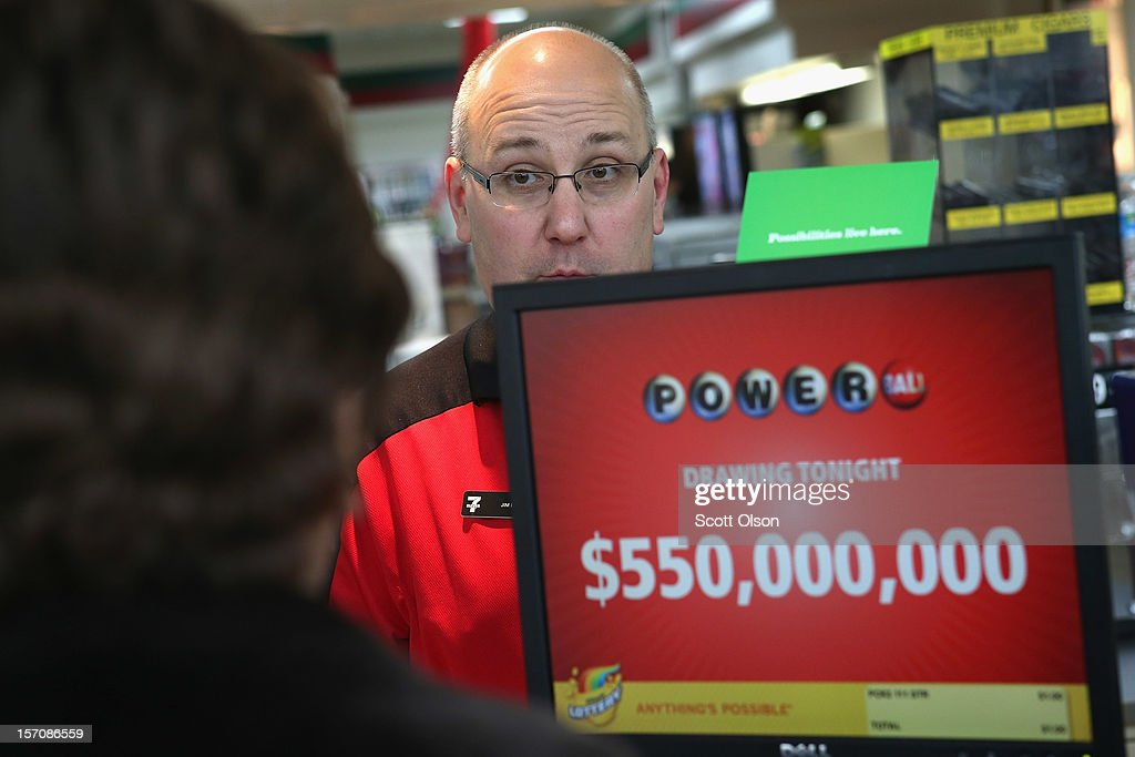 Jim Bayci prints a Powerball lottery ticket for a customer at his 7-Eleven store on November 28, 2012 in Chicago, Illinois. Bayci estimates more than half of his customers included at least one Powerball ticket with their purchase today. The jackpot for Wednesday's Powerball drawing is currently at $550 million which is the richest Powerball pot ever. It is likely to rise even more as people continue to buy before tonights drawing.