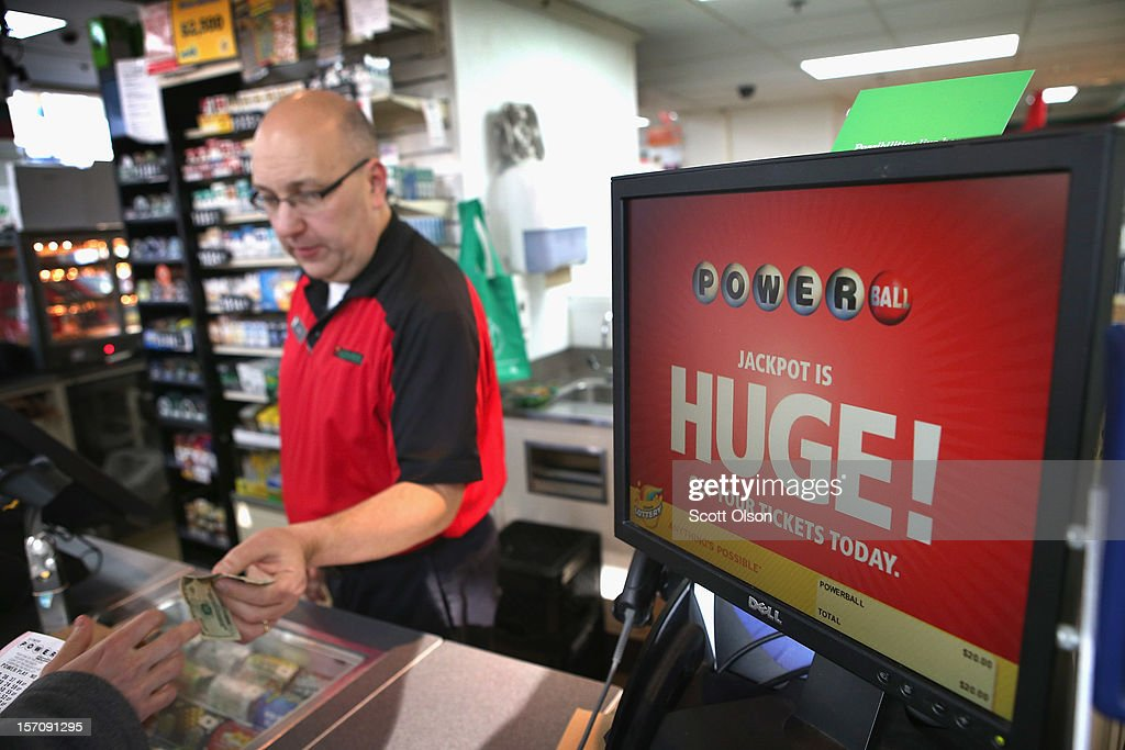 Jim Bayci sells a Powerball lottery ticket at his 7-Eleven store on November 28, 2012 in Chicago, Illinois. Bayci estimates more than half of his customers included at least one Powerball ticket with their purchase today. The jackpot for Wednesday's Powerball drawing is currently at $550 million which is the richest Powerball pot ever. It is likely to rise even more as people continue to buy before tonights drawing.