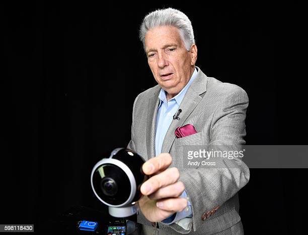 Jim Berry with the Consumer Technology Association displays the ALLie 360 degree camera at the Denver Post August 31 2016