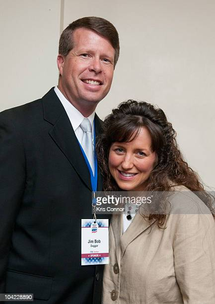Jim Bob Duggar and Michelle Duggar pose for a photographer during a book signing during the 5th Annual Values Voter Summit at the Omni Shoreham Hotel...