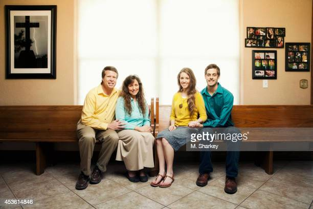 Jim Bob Duggar Michelle Duggar Jill Duggar and Derick Dillard are photographed for People Magazine on March 30 2014 in Bentonville Arkansas