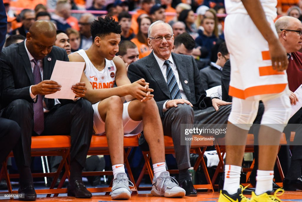Jim Boeheim Head coach of the Syracuse Orange reacts with a smile talking with Matthew Moyer #2 of the Syracuse Orange during the second half of play between the Syracuse Orange and the Pittsburgh Panthers on January 16th, 2018 at the Carrier Dome in Syracuse, NY.