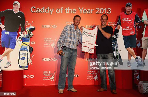 Jim ''Bones'' MacKay receives the winner's caddie bib from Giles Morgan Group Head of Sponsorship HSBC after winning the HSBC Caddy of the Year at...