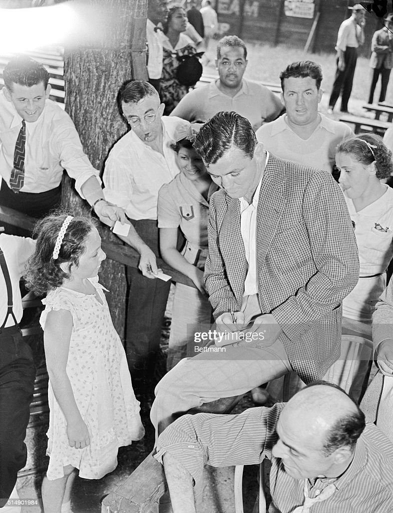 Jim Braddock, former heavyweight champion, signing autographs for the fans as he paid a visit to Joe Louis training camp at Pompton Lakes, N.J., August 4th.