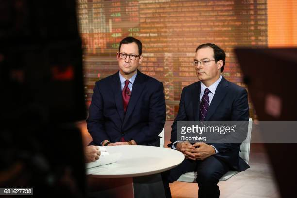 Jim Burns head of individual investor business at Kohlberg Kravis Roberts Co left and Henry McVey head of macro and asset allocation and chief...