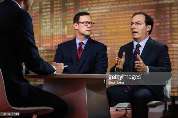 Jim Burns head of individual investor business at Kohlberg Kravis Roberts Co left listens while Henry McVey head of macro and asset allocation and...