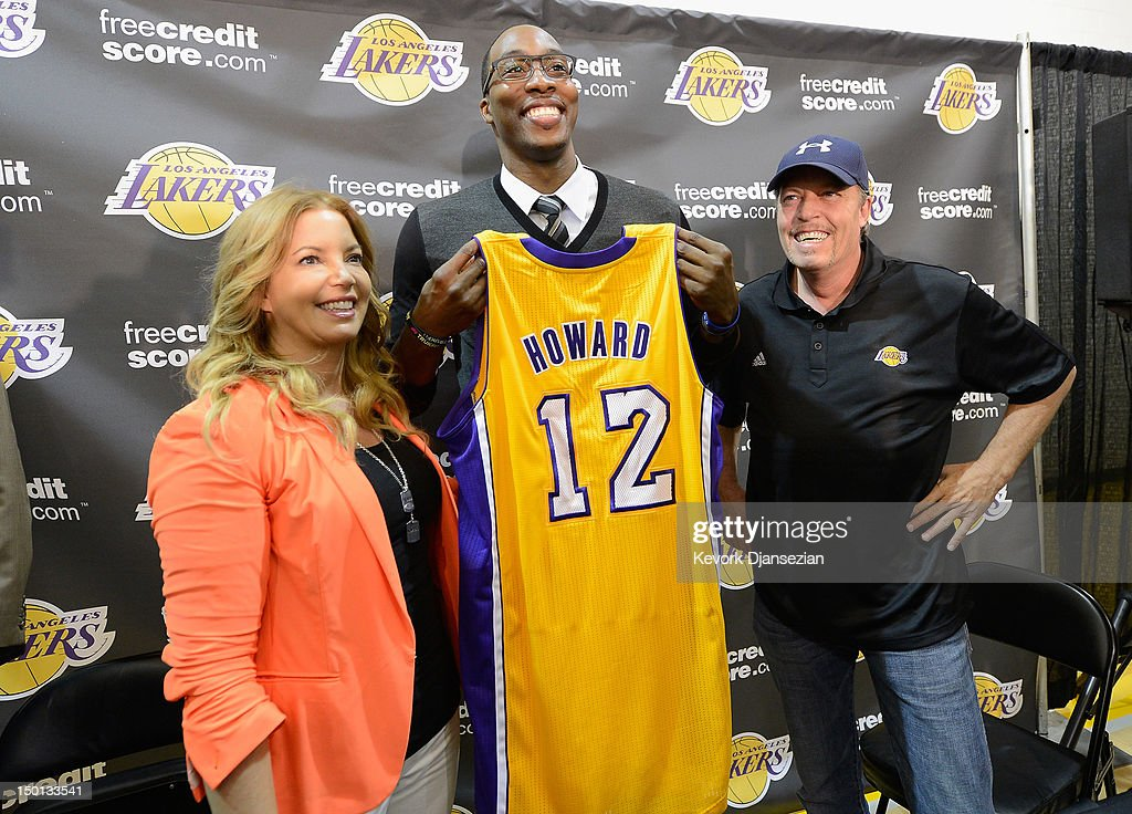 Jim Buss and his sister Jeanie Buss of the Los Angeles Lakers pose with new member of the team <a gi-track='captionPersonalityLinkClicked' href=/galleries/search?phrase=Dwight+Howard&family=editorial&specificpeople=201570 ng-click='$event.stopPropagation()'>Dwight Howard</a> at the Toyota Sports Center on August 10, 2012 in El Segundo, California. The Lakers acquired Howard from Orlando Magic in a four-team trade. In addition Lakers wil receive Chris Duhon and Earl Clark from the Magic.