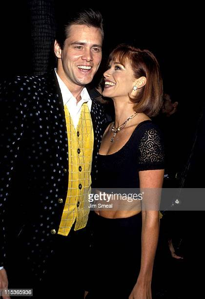 Jim Carrey and Lauren Holly during 'The Mask' Los Angeles Premiere at Academy of Motion Picture Theater in Beverly Hills California United States
