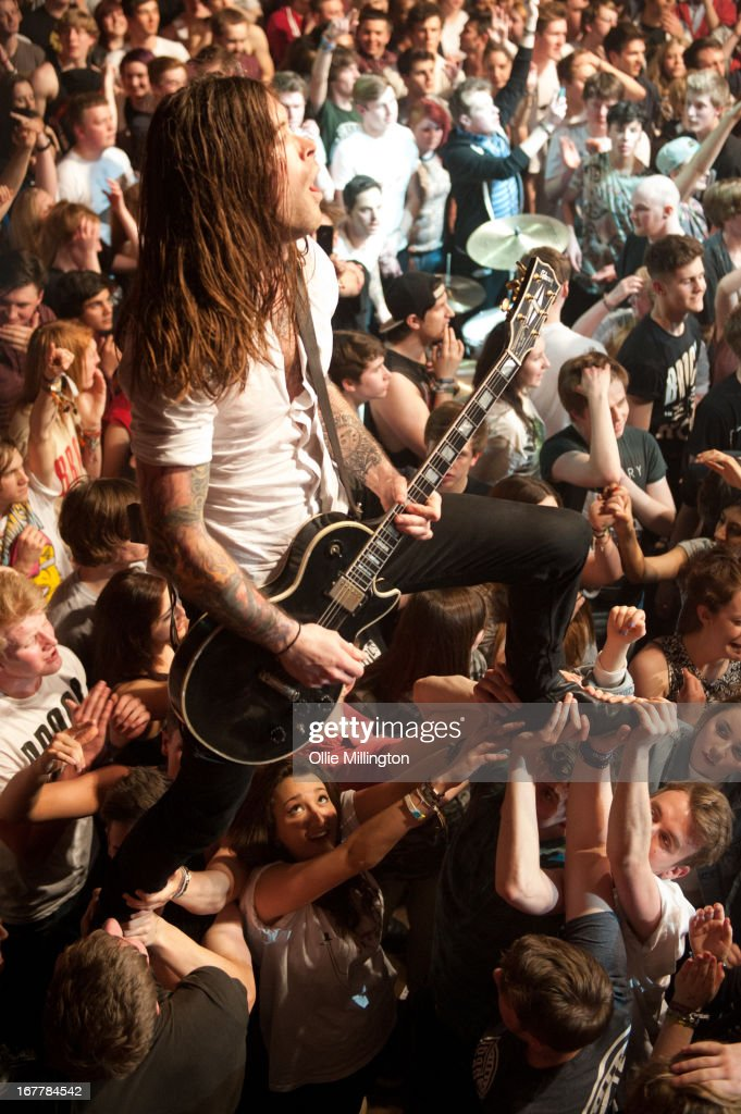 <a gi-track='captionPersonalityLinkClicked' href=/galleries/search?phrase=Jim+Carroll&family=editorial&specificpeople=5640612 ng-click='$event.stopPropagation()'>Jim Carroll</a> of Pure Love perform crowd surfing during a sold out show at KOKO on April 18, 2013 in London, England.