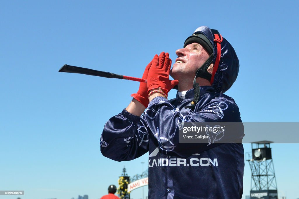 Jim Cassidy prays to the sky after winning aboard Zoustar in Race 4 the Coolmore Stakes during Derby Day at Flemington Racecourse on November 2, 2013 in Melbourne, Australia.