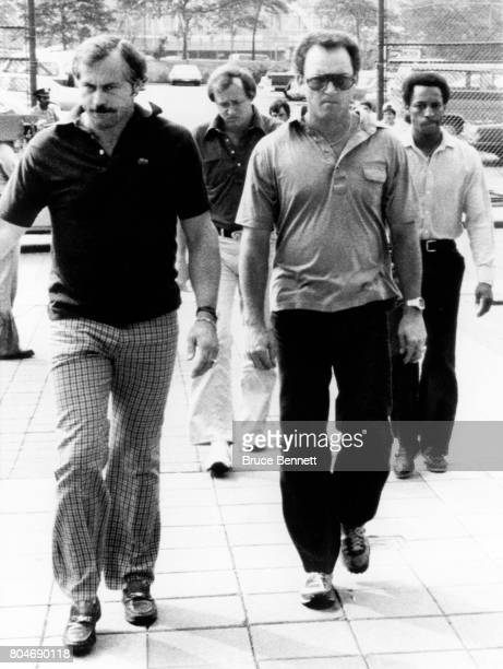 Jim 'Catfish' Hunter Graig Nettles Rich 'Goose' Gossage and Willie Randolph of the New York Yankees arrive at the ballpark the day after their...