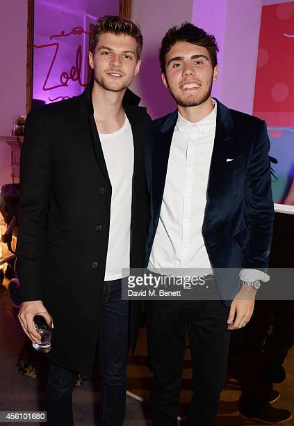 Jim Chapman and Alfie Deyes attend YouTube phenomenon Zoe Sugg's launch of her debut beauty collection at 41 Portland Place on September 25 2014 in...