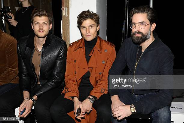 Jim Chapman Oliver Cheshire and Jack Guinness attend the What We Wear show during London Fashion Week Men's January 2017 collections at on January 7...