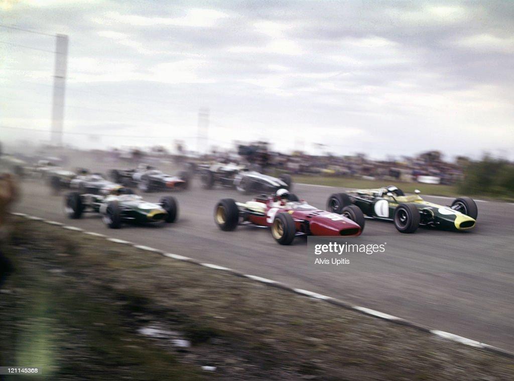Jim Clark in Lotus BRM leads Lorenzo Bandini's Ferrari 312 at start of the United States Grand Prix on October 2 1966 at Watkins Glen New York