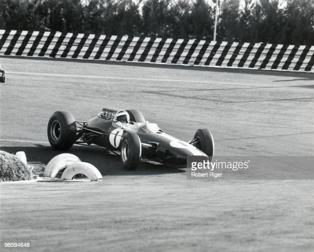 Jim Clark races during the 1964 Mexican Grand Prix at the Autodromo Hermanos Rodriguez on October 25 1964 in Mexico City Mexico